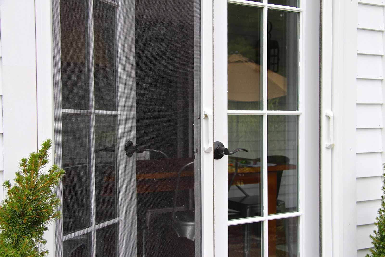 Phantom retractable screens custom retractable screens for Screens for french doors that swing in